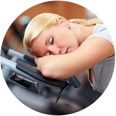 A lady feeling fatigued during the workout