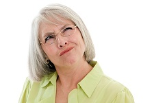 mature woman making a confused face